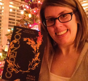 Me holding my copy of Golden Son after my crazy dance party in the kitchen.